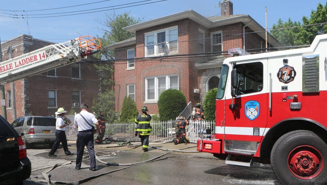 Yonkers firefighters along with mutual aid companies work at the scene of a house fire at 7 William St. in Yonkers on May 18, 2017. Resident Aida Santiago, 54, died as a result of the fire.