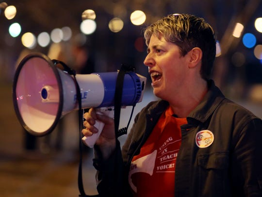 Amanda Kail, MNPS teacher and one of the organizers of the protest against Betsy DeVos outside Riverfront Park in Nashville, leads a chant Thursday, November 30, 2017.