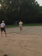 Gerry Wenzel runs to home base during the group's baseball game.