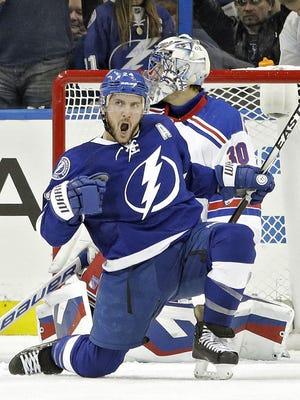 Tampa Bay Lightning right wing Ryan Callahan celebrates his goal past Rangers goalie Henrik Lundqvist  during Wednesday night's game.