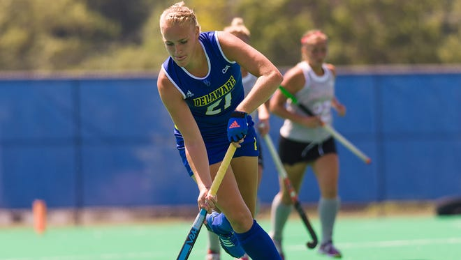 Greta Nauck moves the ball downfield for Delaware in its field hockey opener vs. Ohio State at Rullo Stadium. Nauck had four goals in a 5-2 win.