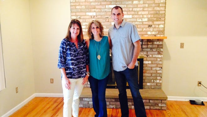 """Brit Roberts (left) stands with Erin McClure (center) and Ben Miller. McClure and Miller will be featured on an episode of HGTV's """"House Hunters"""" this week."""
