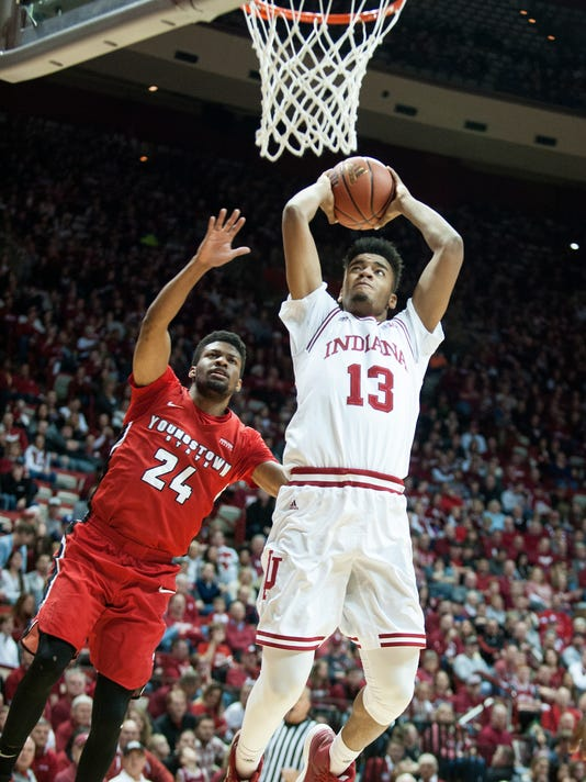 Indiana forward Juwan Morgan (13) shoots over Youngstown State guard Cameron Morse (24) during the second half of an NCAA college basketball game in Bloomington, Ind., Friday, Dec. 29, 2017. (Alex McIntyre/The Herald-Times via AP)