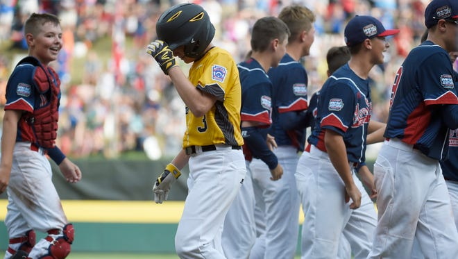 Goodlettsville's Carson Rucker walks off the field after the team's loss to New York in the U.S. Little League championship game  on Saturday.