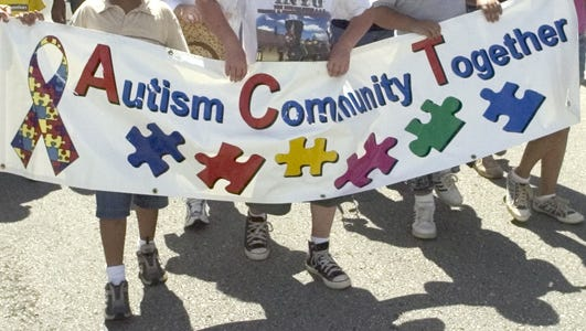 At the Autism Community Together walk, supporters carry their banner on April 30, 2006 at Adelup. ACT will have its 9th Autism Awareness Fair on Saturday, April 2, at the Agana Shopping Center.