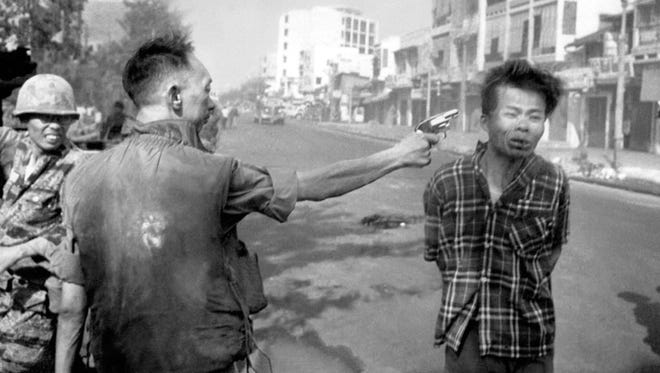 South Vietnamese Gen. Nguyen Ngoc Loan, chief of the national police, shoots suspected Viet Cong officer Nguyen Van Lem, also known as Bay Lop, on Feb. 1, 1968, on a Saigon street early in the Tet Offensive.