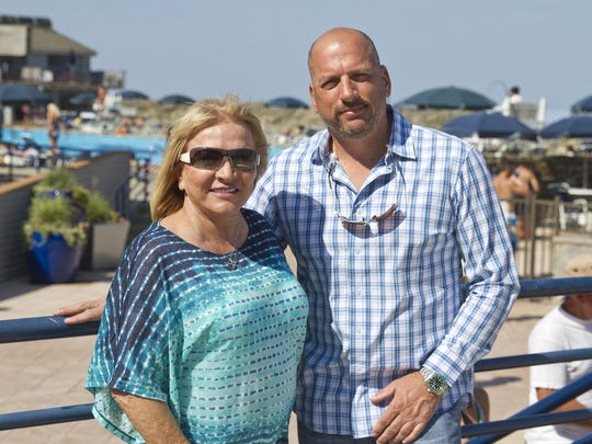 Co-owners of the property Carol Stavola and her son Bill Stavola relax near the pool. The Driftwood Cabana Club offers members a luxurious day at the beach.