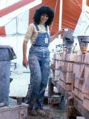 This 1979 photo shows artist Jan Axel, shown here in her 1979 residency, at work in a tent outside the Kohler Co. in Kohler, Wis. Axel has completed two residencies at Kohler. artisan factory workers so that both can learn from each other.