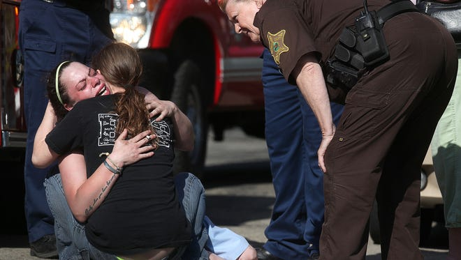 The mother of a 3-year-old boy who died in a house fire at 1724 S. Daly St. is comforted at the scene. Firefighters battled a fire that quickly engulfed the one story home. The mother of the child that died, a man who was in the home and a 16-month old child were able to escape the home with non serious injuries. Police set up a crime scene at the site after firefighters contained the blaze.  The cause of the fire is currently under investigation.
