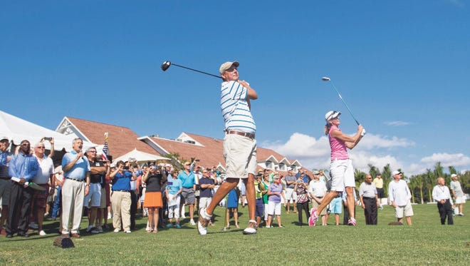 Terry-Jo Myers and Nolan Henke hit the ceremonial first tee shots together at the grand reopening of Fort Myers Country Club on Friday, October 31, 2014.