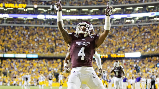BATON ROUGE, LA - SEPTEMBER 20: Jameon Lewis #4 of the Mississippi State Bulldogs points to the crowd after scoring a touchdown against the LSU Tigers at Tiger Stadium on September 20, 2014 in Baton Rouge, Louisiana.  The Bulldogs defeated the Tigers 34-29.  (Photo by Wesley Hitt/Getty Images)