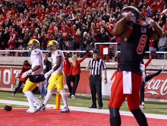 Utah receiver Kaelin Clay celebrates the touchdown