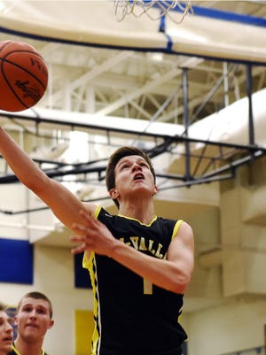 Tri-Valley's Matt King shoots a layup in traffic during the Scotties' 63-52 win against Philo on Tuesday night at The Power Plant. The Scotties face John Glenn on Friday night with first place in the Muskingum Valley League on the line.