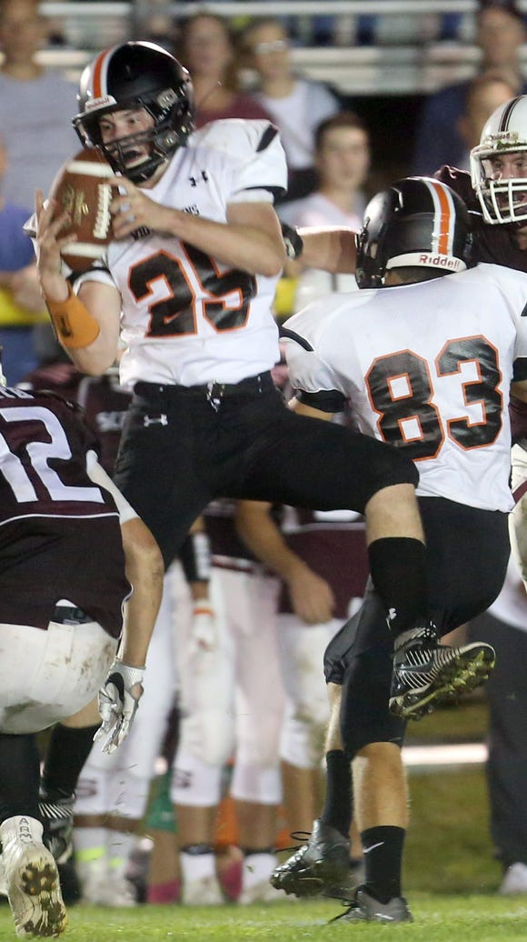 Antony Russo of White Plains hauls in a reception during