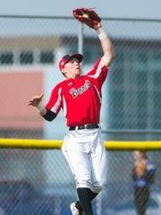 James M Bennett left fielder Grayson Winterbottom (20) leaps for a Stephen Decatur fly ball at Stephen Decatur High in Berlin on Thursday, March 31.
