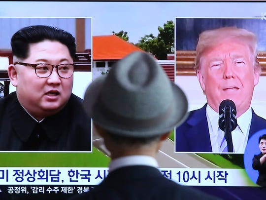 A man watches a TV screen showing file footage of President Donald Trump, right, and North Korean leader Kim Jong Un during a news program at the Seoul Railway Station in Seoul, South Korea, June 11, 2018.