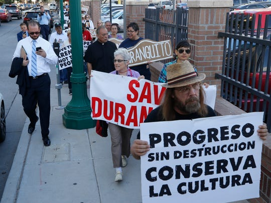 Duranguito protesters marched to City Hall to protest any potential demolition of buildings in the old neighborhood Tuesday morning.