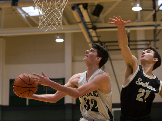 Colts Neck's Zach Albom dives under the basket with