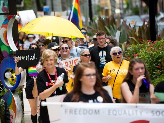 Supporters of the LGBTQ community, over 100 in all, march down Fifth Avenue in downtown Naples during Collier Freedom's first ever Naples Equality March on Sunday, June 11, 2017.