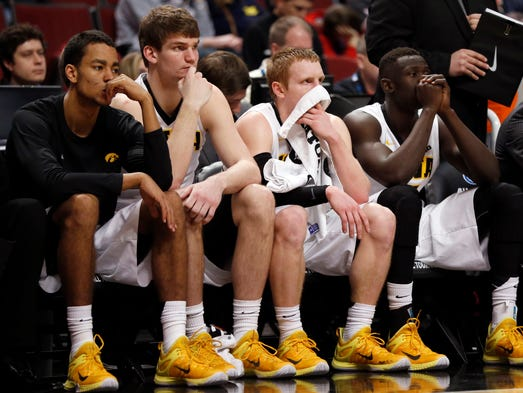 Iowa players watch from the bench in the second half