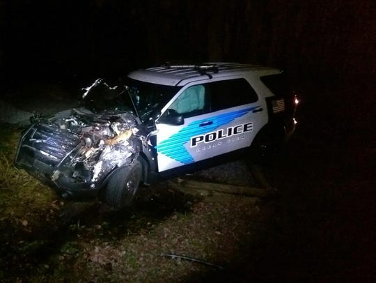 Officer First Class Nicholas Harrington's patrol car after it was rammed into by a suspect during a police chase Saturday, March 18, 2017.
