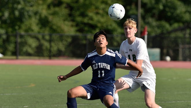 NV/Old Tappan's JeeHo Yun (10) and Pascack Valley's Nate Dedrick (18) battle for control during their game in Hillsdale.