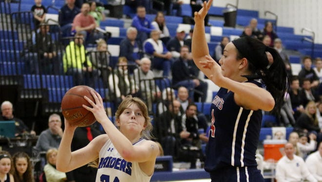 Jillian Casey of Horseheads goes up for a shot as Annie Ramil of Binghamton defends Friday in a Section 4 Class AA semifinal at Horseheads Middle School.