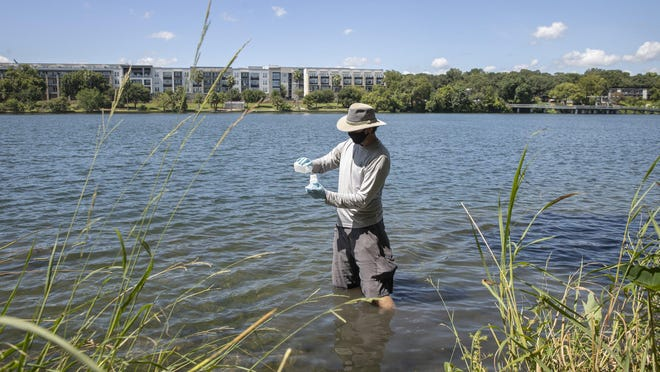 Brent Bellinger, a senior environmental scientist for the Austin Watershed Protection Department, takes water samples from Lady Bird Lake at Festival Beach on Wednesday.
