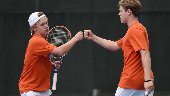 Madison Central's Walker Ellis (left) and Trey Randall celebrate a point against Ocean Springs on Monday.