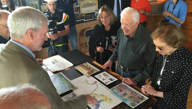 Former President Jimmy Carter, 91, and his wife, Rosalynn, meet June 10, 2016, with Answers in Genesis' co-founder and chief executive, Ken Ham, left, before touring the Ark Encounter park in Williamstown, Ky.
