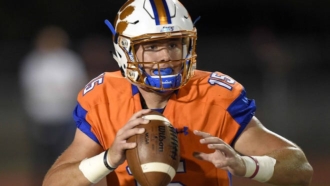 Madison Central quarterback Jack Walker looks for a receiver down field against Clinton on Friday, September 23, 2016, at Madison Central High School in Madison, Miss.