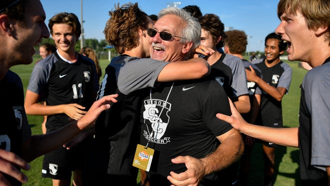 Station Camp head coach Thomas Morand celebrates with his team after their Class AAA championship victory against Houston at the Richard Siegel Soccer Complex in Murfreesboro, Tenn., Friday, May 26, 2017.