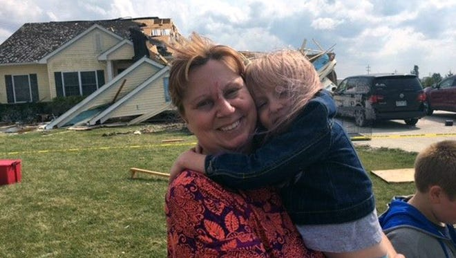Susan Cooper, and her 4-year-old daughter, Alyse, escaped serious injury after a storm Sept. 3, 2017, that hit Crestline, Ohio, sucked them from the girl's bedroom into the backyard.