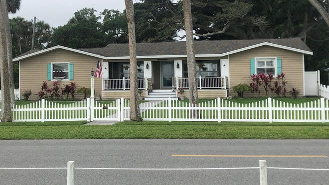 This totally renovated riverfront home in Port Orange is situated on a large corner lot that has riparian rights and a dock/lift.
