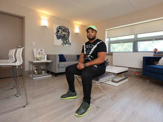 Resident Gary Rivera is pictured in the living room