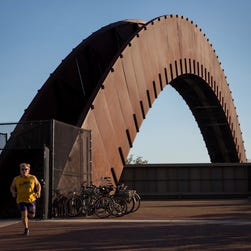 """The Piety Street Bridge, known locally as the """"rusty rainbow,"""" funnels people into Crescent Park in the Bywater neighborhood."""