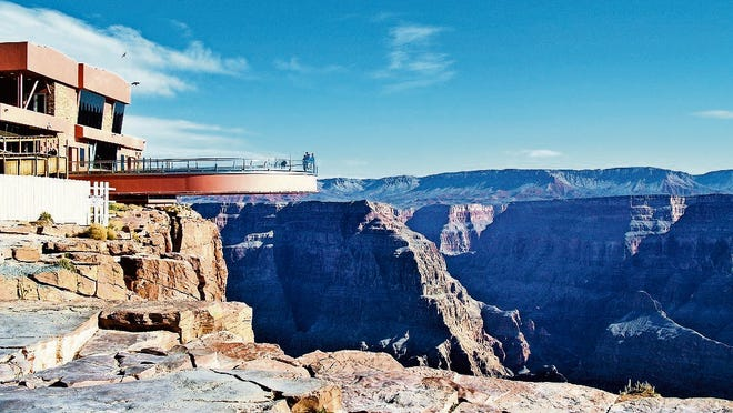 The Skywalk allows guests to traverse 70 feet out over the Grand Canyon's rim and peer through its glass walkway at the canyon floor 4,000 feet below.
