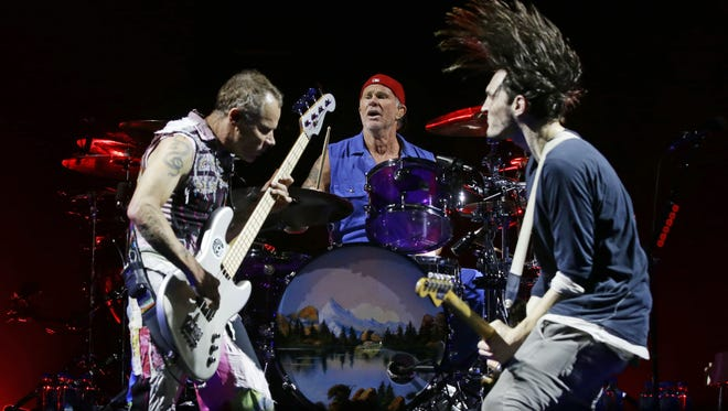Red Hot Chili Peppers perform on Oct. 18, 2017 during its Getaway tour performance at Gila River Arena in Glendale, Ariz.