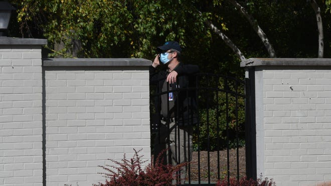 A man seen just inside the governor's residence in Lansing early Thursday afternoon, Oct. 8, 2020. due a recent threat, security measures such as a newly placed metal fence surround the perimeter of the property.