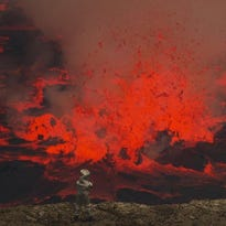 In this March 31, 2010 photo, magma churns and gushes in the lava lake of Mount Nyiragongo.
