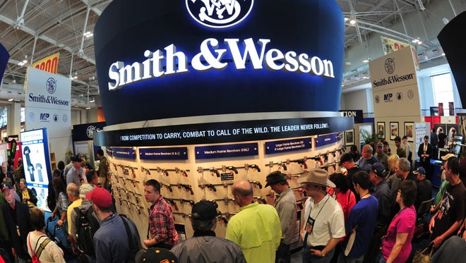 File photo taken in 2015 shows convention attendees viewing firearms at the Smith & Wesson booth during the National Rifle Association annual convention in Nashville, Tennessee.