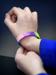 "Marcell McCartney, 9, wears a bracelet that reads ""No"