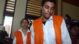 Tommy Schaefer, right, and Heather Mack, arrive for their trial at Denpasar's district court in Bali.