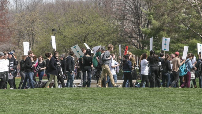 Butler University students and faculty gathered on campus Thursday, April 17, 2014, in support of Butler Student Eliza Quincey, who wrote a essay about her experience reporting her alleged rapist to campus police. Student also read a list of demands aimed at the administration.