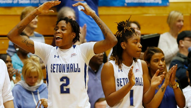 Seton Hall's Tiffany Jones (2) and Tabatha Richardson-Smith (1) react in the final seconds of an NCAA college basketball game against Georgia at Walsh Gym in South Orange, N.J., Sunday, Dec. 28, 2014. Seton Hall defeated Georgia 70-51.