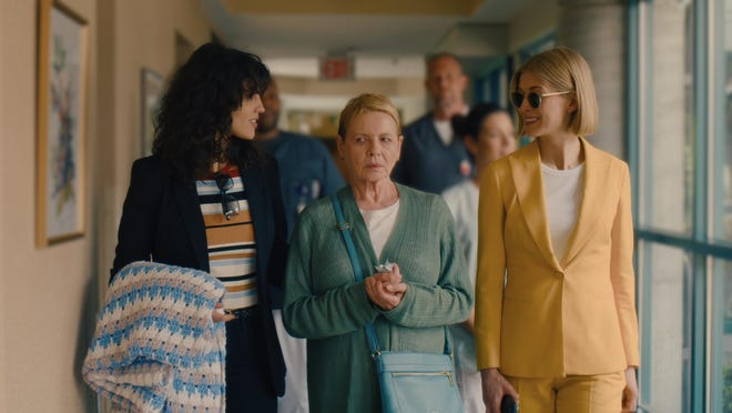 """Eiza González, left, Dianne Wiest and Rosamund Pike in """"I Care a Lot."""""""