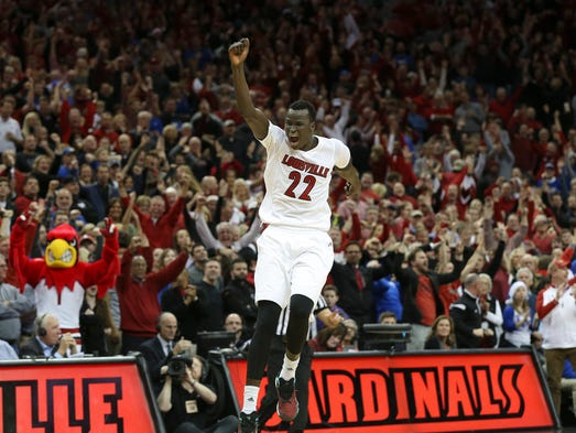 U of L's Deng Adel (22) reacted after they defeated