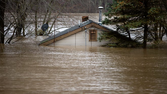 A shed in California is under water due to flooding along the Ohio River. Many residents on Panama Street are helping each other get their belongings to high ground. Many roads are closed due to flooding of the Ohio River which isn't supposed to crest until Tuesday at around 59 feet, the highest since 1997.