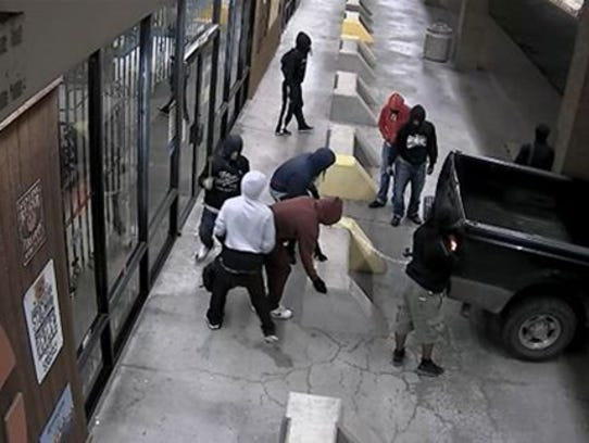 Surveillance video captured the suspects using a pickup