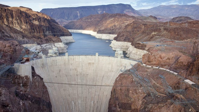 Mark Henle/The Republic  Contrary to rumors, no workers are entombed in Hoover Dam?s 4.4 million cubic yards of concrete. The Hoover Dam, originally known as Boulder Dam, was dedicated by President Franklin D. Roosevelt in 1935. Nearly a million people tour the dam each year.